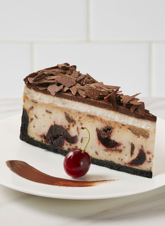 A slice of Chocolate Cherry Cheesecake