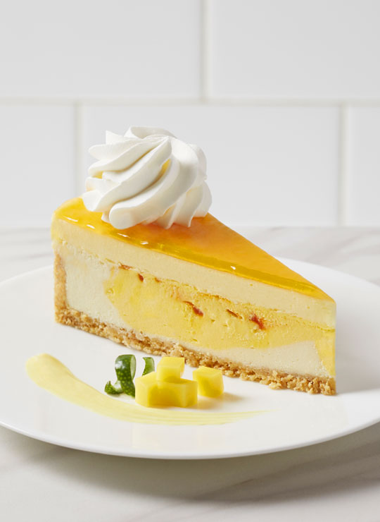 A slice of Mango Key Lime Cheesecake