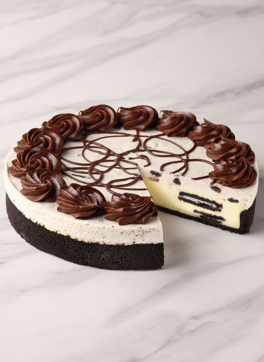 A slice of the Oreo Cookies and Cream Cheesecake
