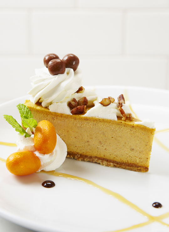 An image of a slice of pumpkin cheesecake
