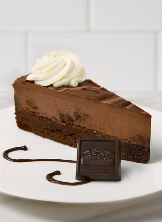 A slice of Triple Chocolate Cheesecake made with Ghirardelli