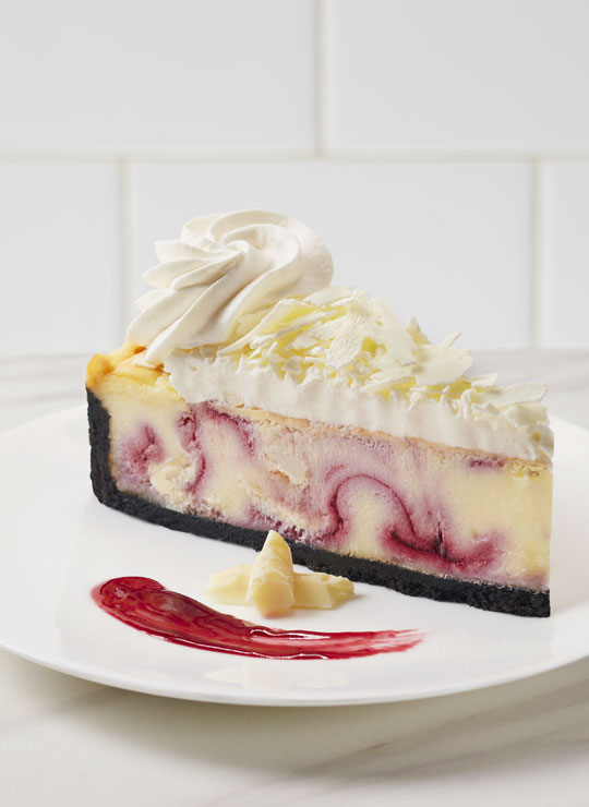 A slice of White Chocolate Raspberry Cheesecake